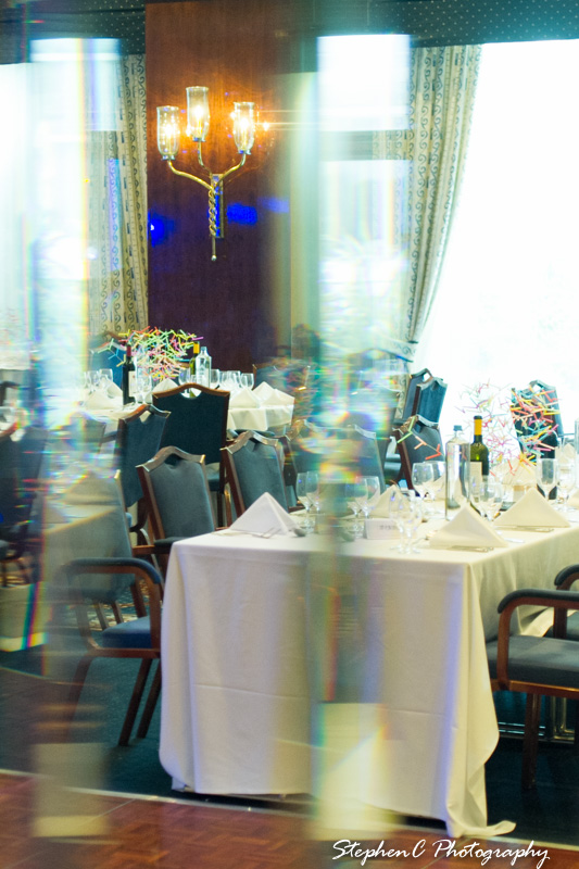Mirrored view of one of the many dining setups.